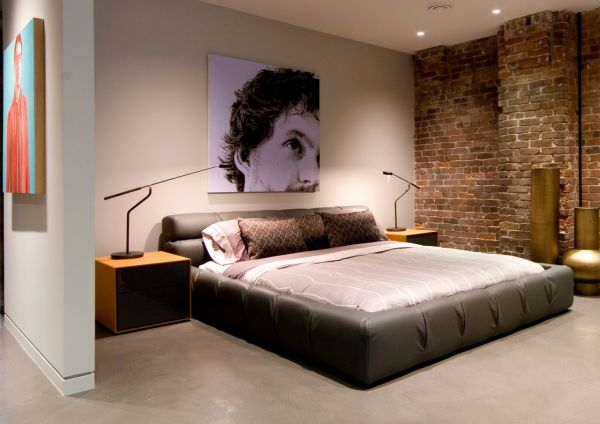 Exposed brick walls add an eclectic appeal 60 Stylish Bachelor Pad Bedroom Ideas