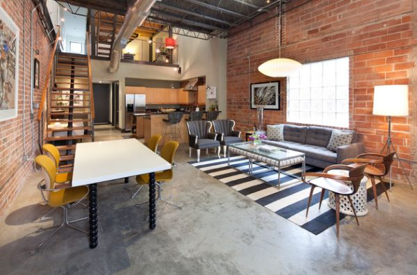 Exposed steel pipes and brick walls usher in the industrial style 70 Bachelor Pad Living Room Ideas