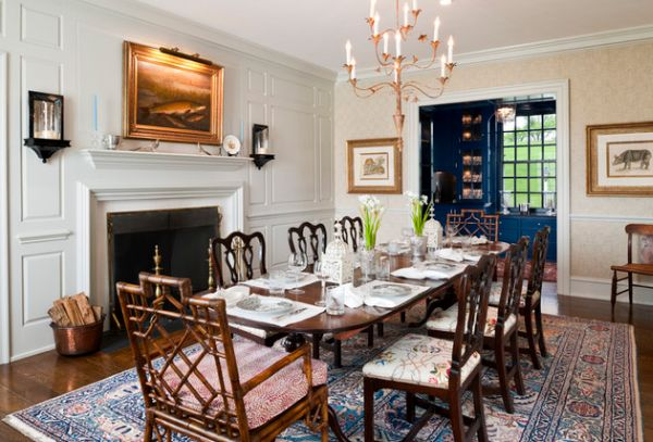Farmhouse style dining room with traditional fireplace