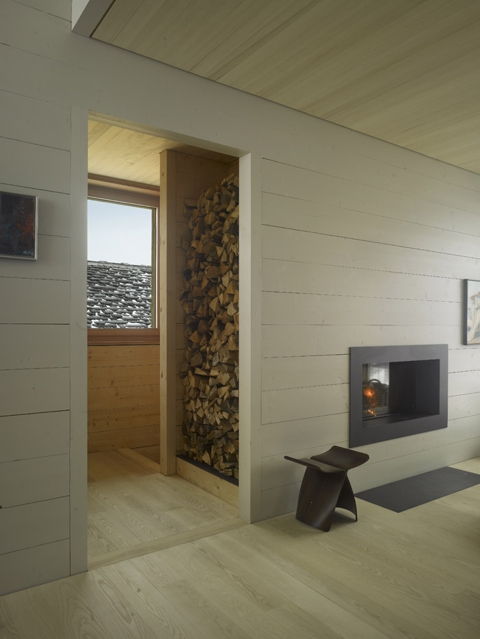 Fireplace with wood stacked next to it