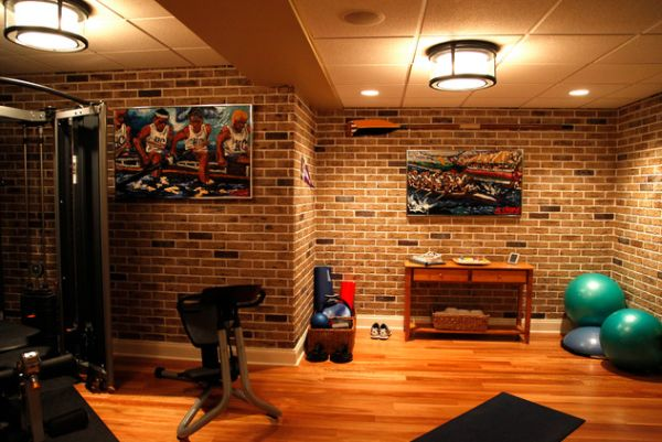 Give your home gym an inimitable look with the exposed brick wall backdrop