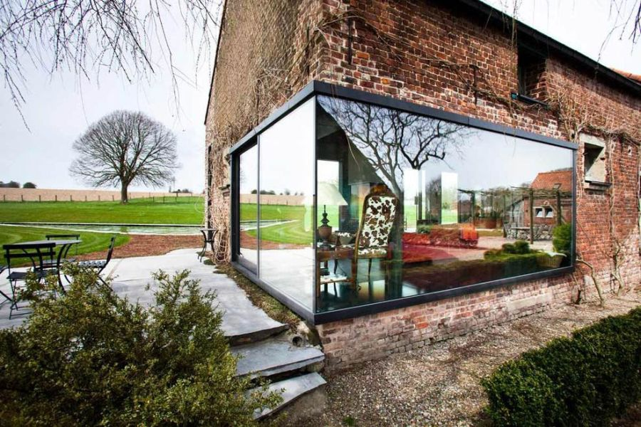 Glass box-in-box style installation to the old farmhouse