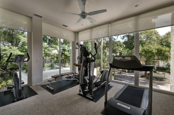 Glass walls create a light, breezy atmosphere inside the home gym