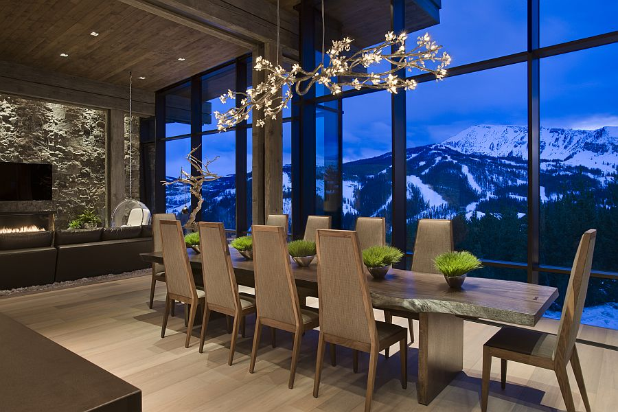 Gorgeous chandelier above the dining table Private Luxury Ski Resort in Montana by Len Cotsovolos