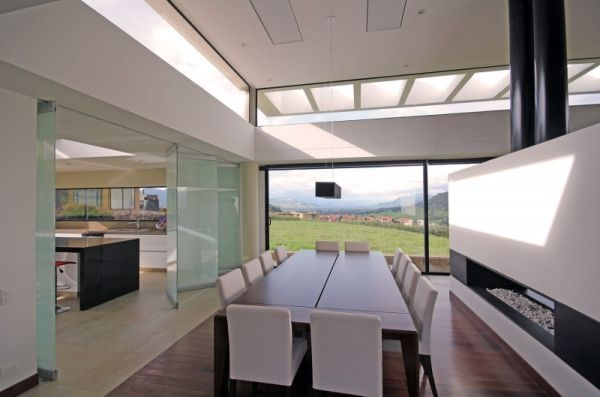 Grand dining room with a modern fireplace and a great view