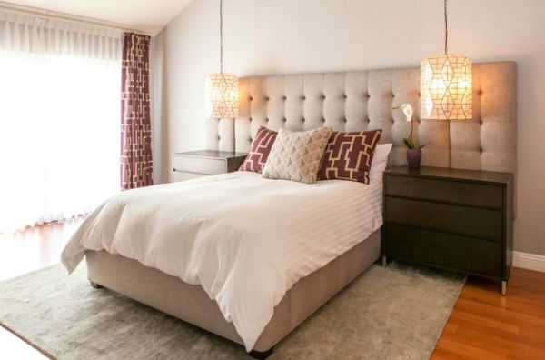 High-end hotel styled bedroom with an over-sized tufted headboard