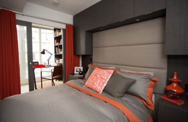 Hints of orange and red spice up the beautiful bedroom