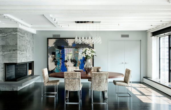 Industrial style dining room with marble slab and blackened steel fireplace