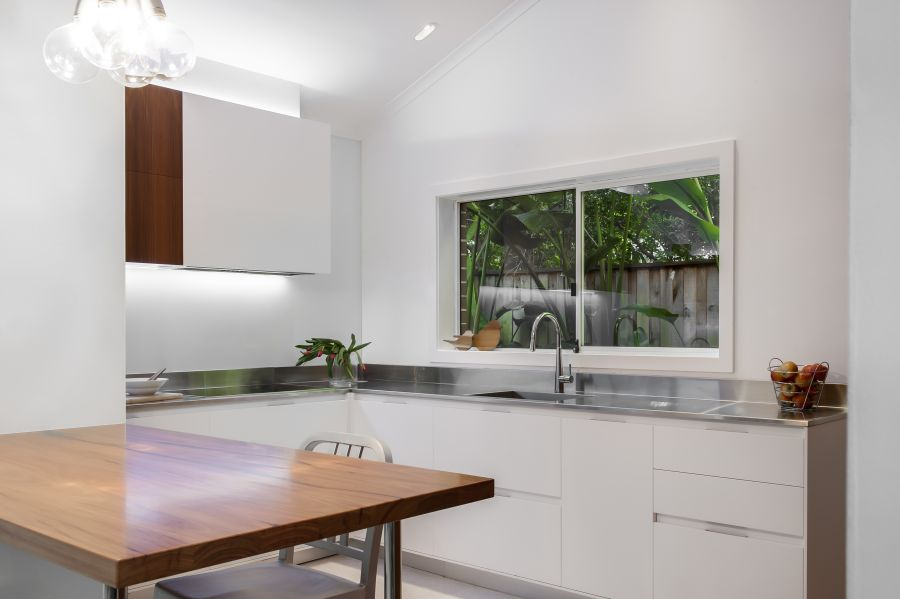 Kitchen window offers views of greenery outside Small Contemporary Kitchen Makes Room For Home Office and Laundry