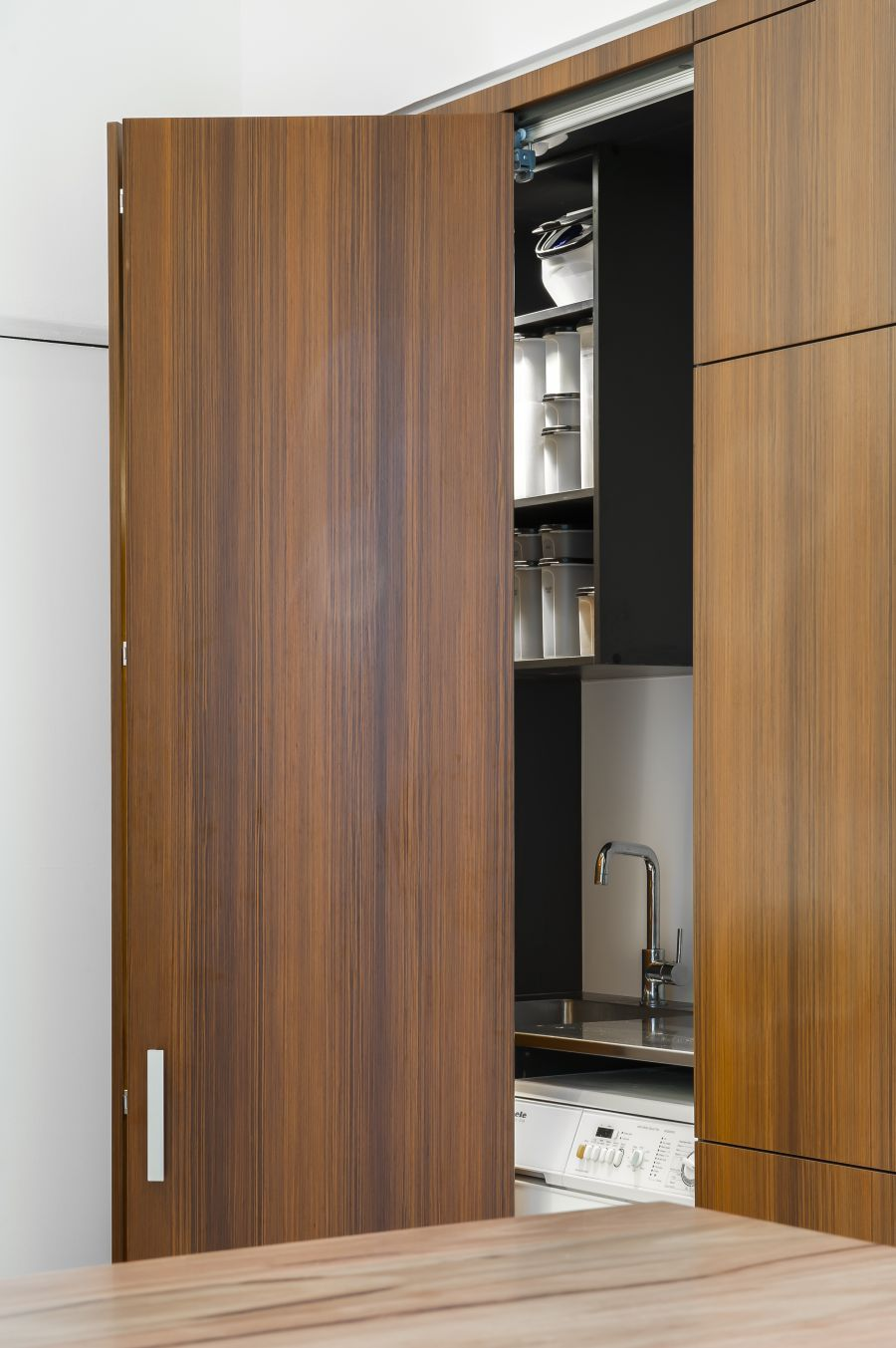 Hidden Kitchen Small Contemporary Kitchen Makes Room For Home Office And Laundry