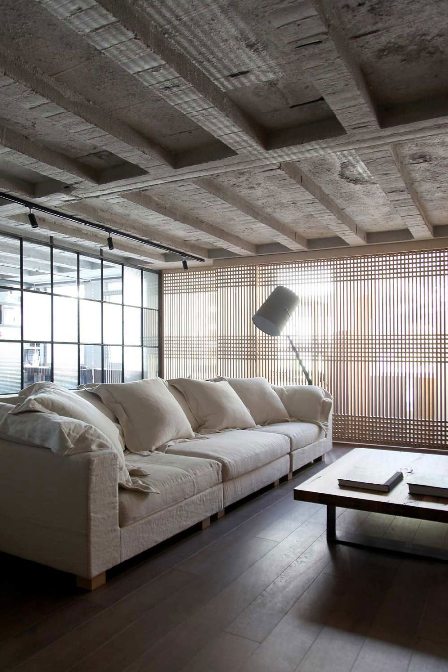 Large window screens and plywood separtaors in the living room Stunning Greek Loft Doubles As A Dazzling Design Studio!