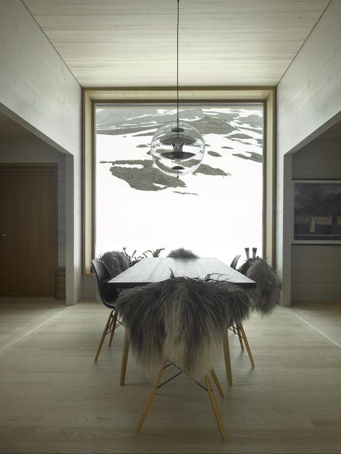 Large windows offer views of snow-filled alpines ski slopes