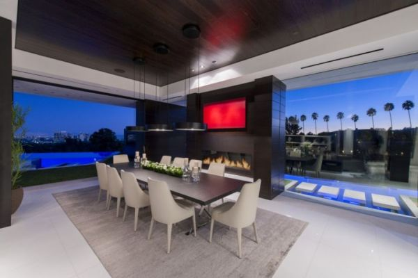 Lavish contemporary dining area with fireplace