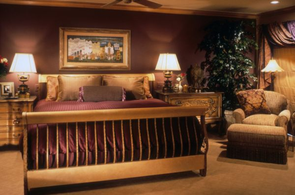 Lavish master bedroom with a sleigh style bed