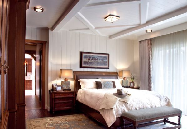 Leather custom-made sleigh bed blends in with the rustic theme