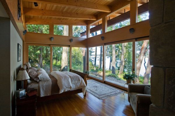 Lovely lake view bedroom with an elegant sleigh bed
