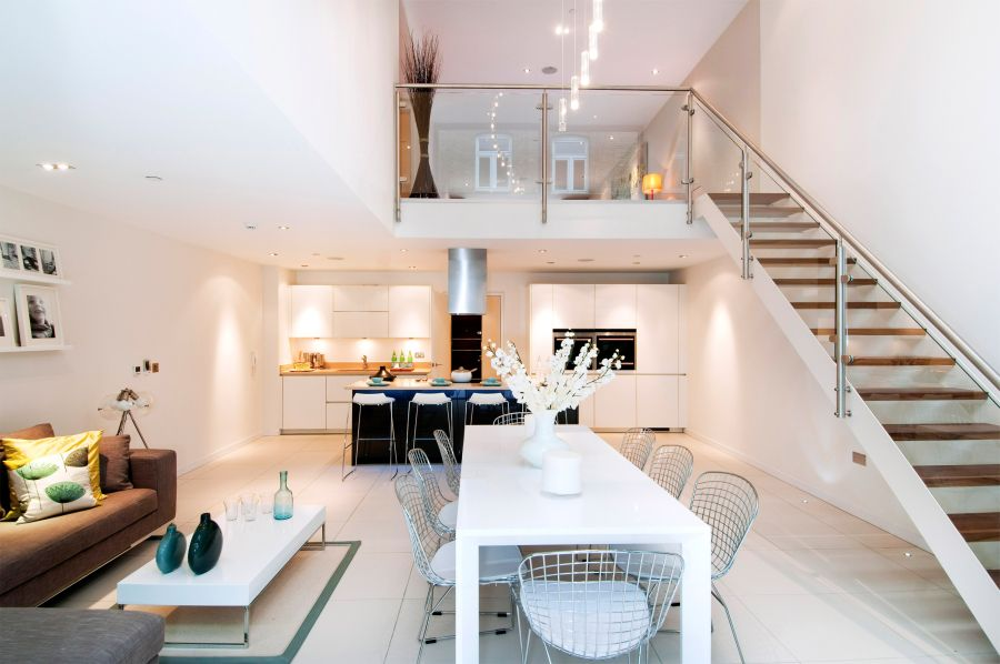 Lower level with the kitchen and the living area Private London Residence Sizzles With Smart Decor And A Dramatic Glass Feature