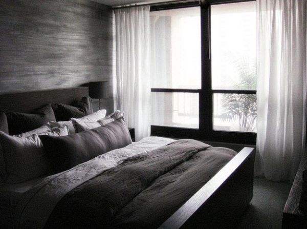Minimalist Bedroom In Dark Colors And Contrasting White Drapes
