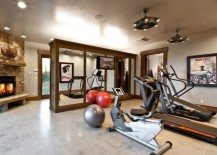 Mirrored-cabinets-in-the-homy-gym-provide-additional-storage-space-217x155
