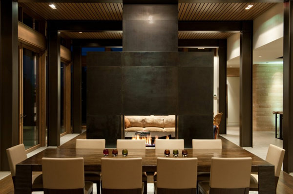 Modern dining area with a stylish fireplace