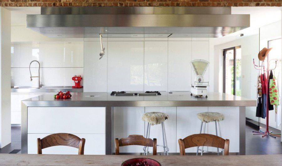 Modern kitchen in white with a steel countertop island