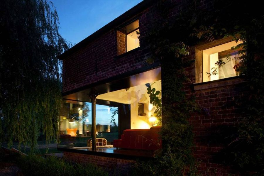 Modern renovation to classic brick farmhouse