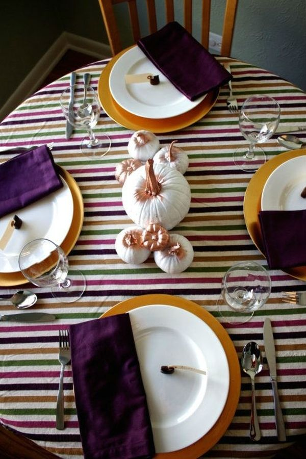 Multicolor striped tablecloth gives the Thanksgiving table a trendy look