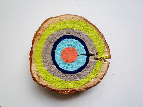 Painted tree ring wall art