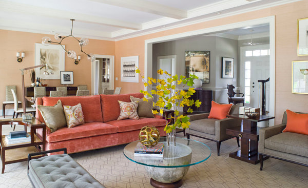 Peach and coral tones in a chic living and dining space