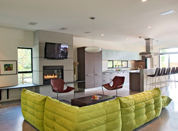 Plush Togo sofa in apple green coupled with twin Paulistano chairs in brown