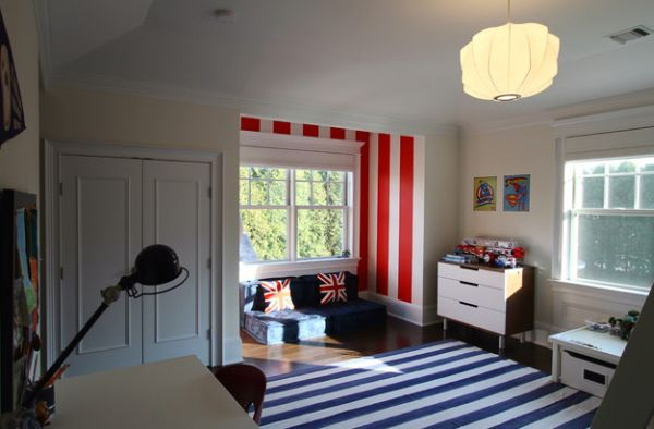 Sitting area in the boys' bedroom stands out thanks to the red and white stripes