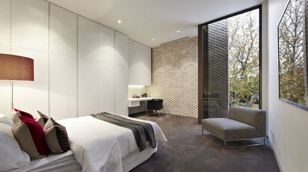 Sleek and modern bedroom with plenty of shelf space
