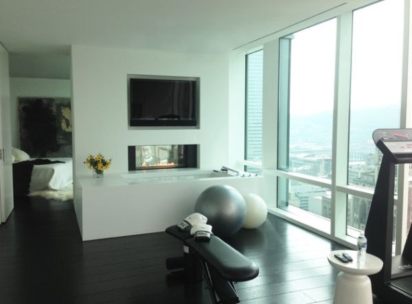 Sleek and stylish exercise room connected to the bedroom