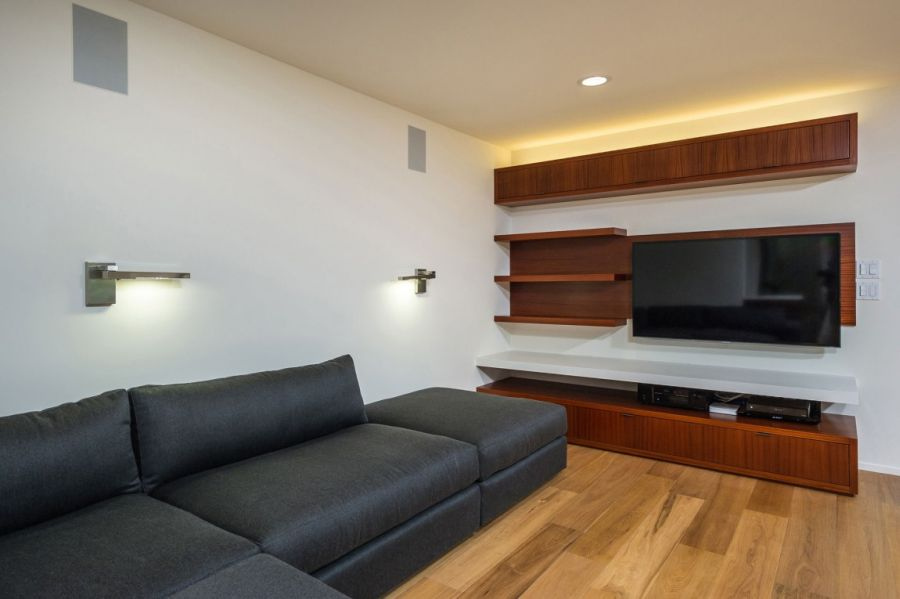 Sleek floating shelves in the living roomw with a grey sofa