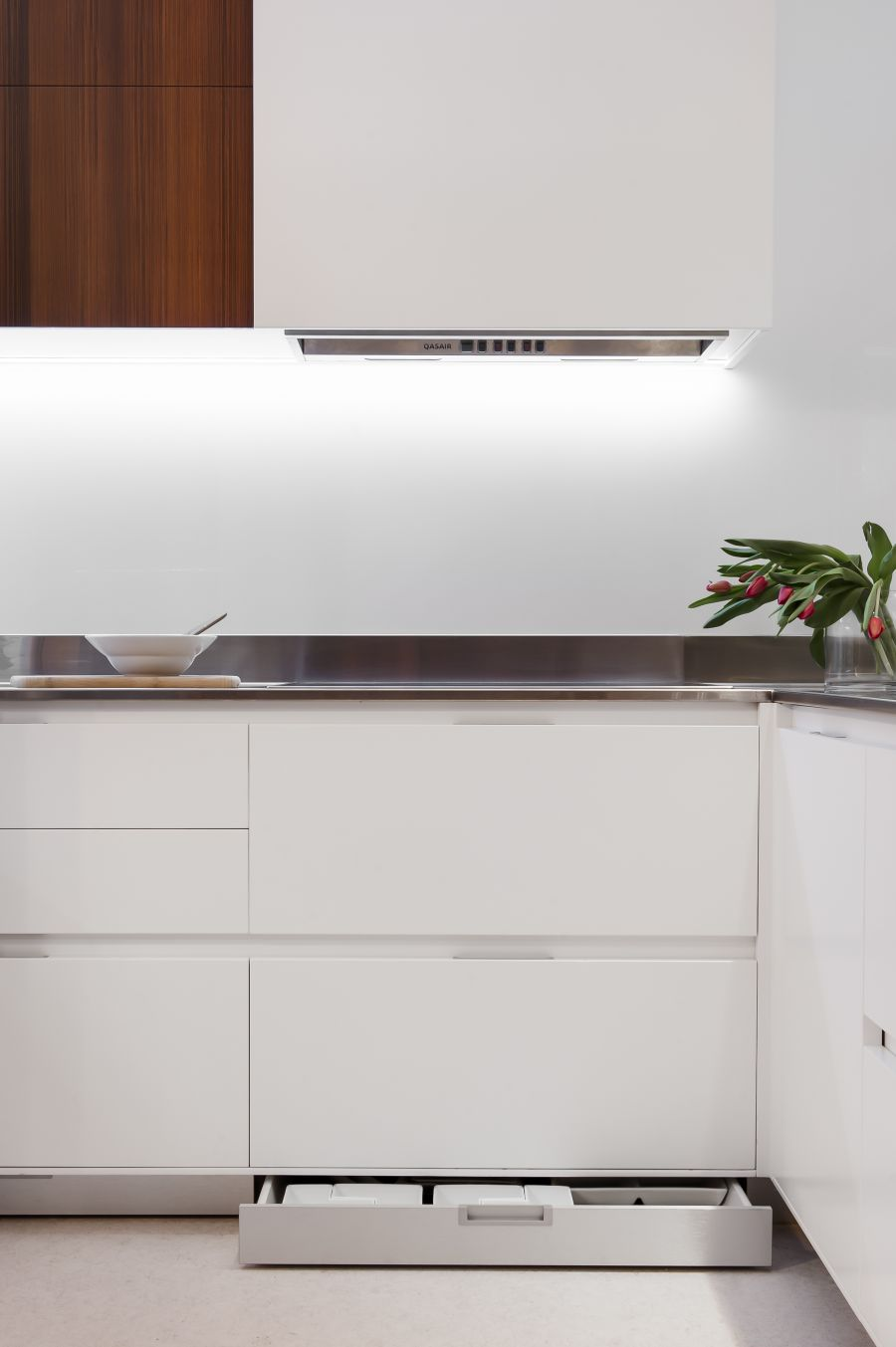 Sleek kitchen storage shelves in white