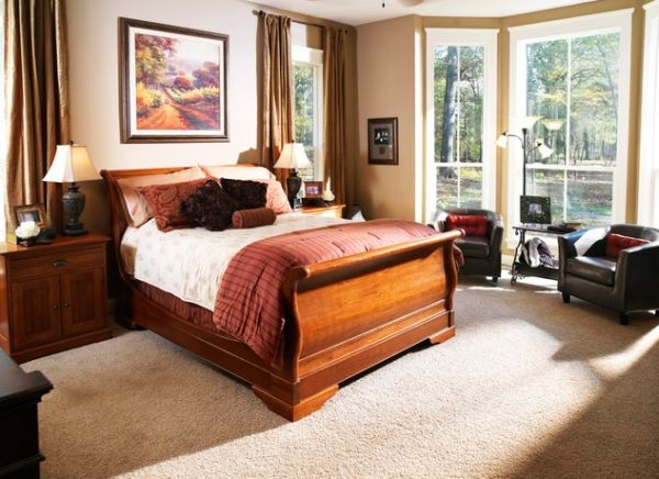 Small bedroom with a sleigh bed and ample natural ventilation