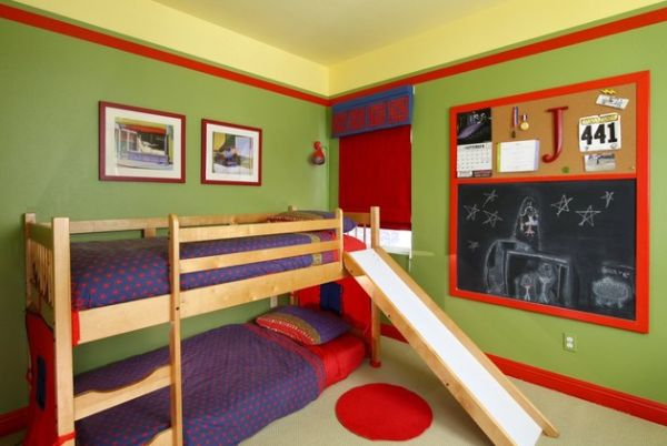 Small bunk bed with a slide in a colorful kids' bedroom