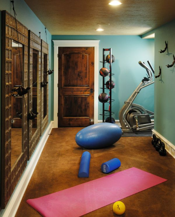 compact home gym with a basketball organizer and lovely mirrors - In Home Gym Designs