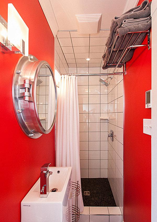 Small red bathroom with overhead storage