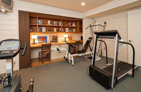 Smart home gym with home office tucked away in the closet