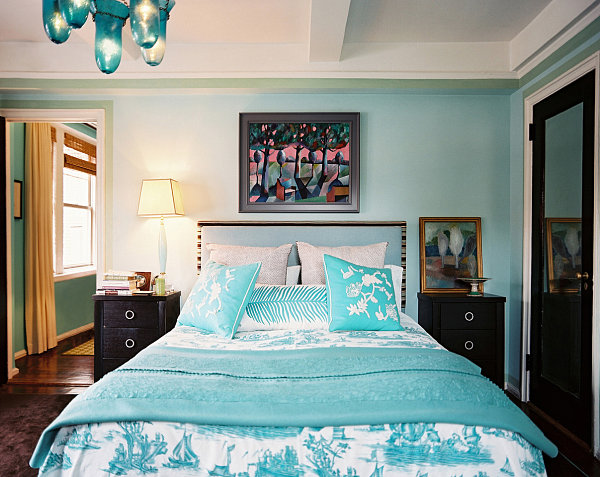 Soothing blue bedroom with tropical touches