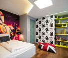 Star wars themed boys' bedroom with hand-painted murals