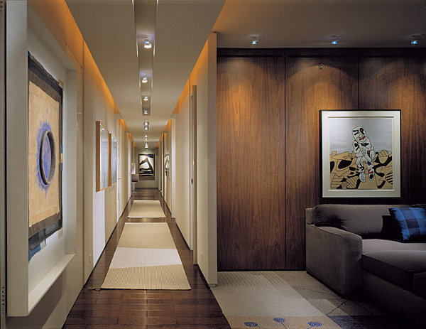 Statement lighting in a contemporary hallway