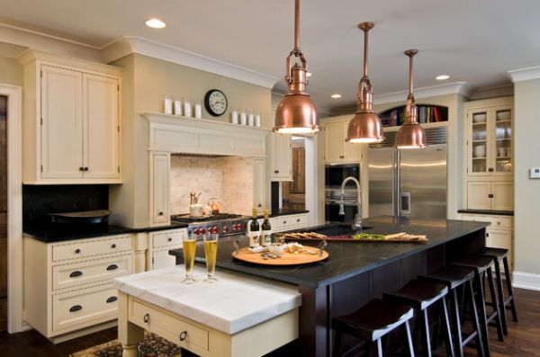 Steampunk styled copper pendant lights in kitchen