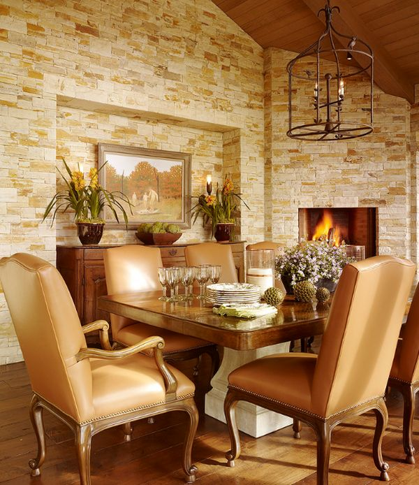 Stone walls and the fireplace give this dining room a truly timeless appeal