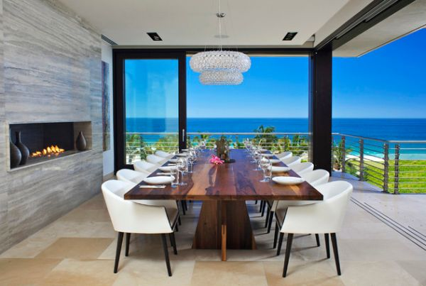 Stunning dining room with ocean views and a contemporary stone fireplace