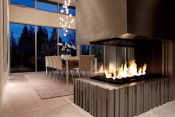 Stylish fireplace serves both the dining room and the kitchen