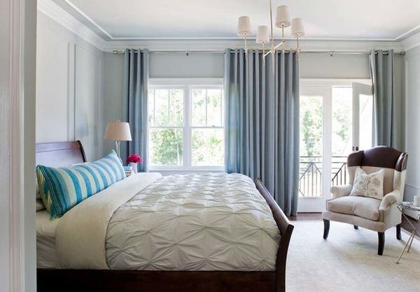 The sleigh bed anchors the bedroom filled with cool blue shades