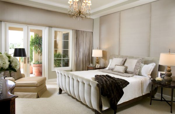 Upholstered wall adds to the luxurious look of the bedroom