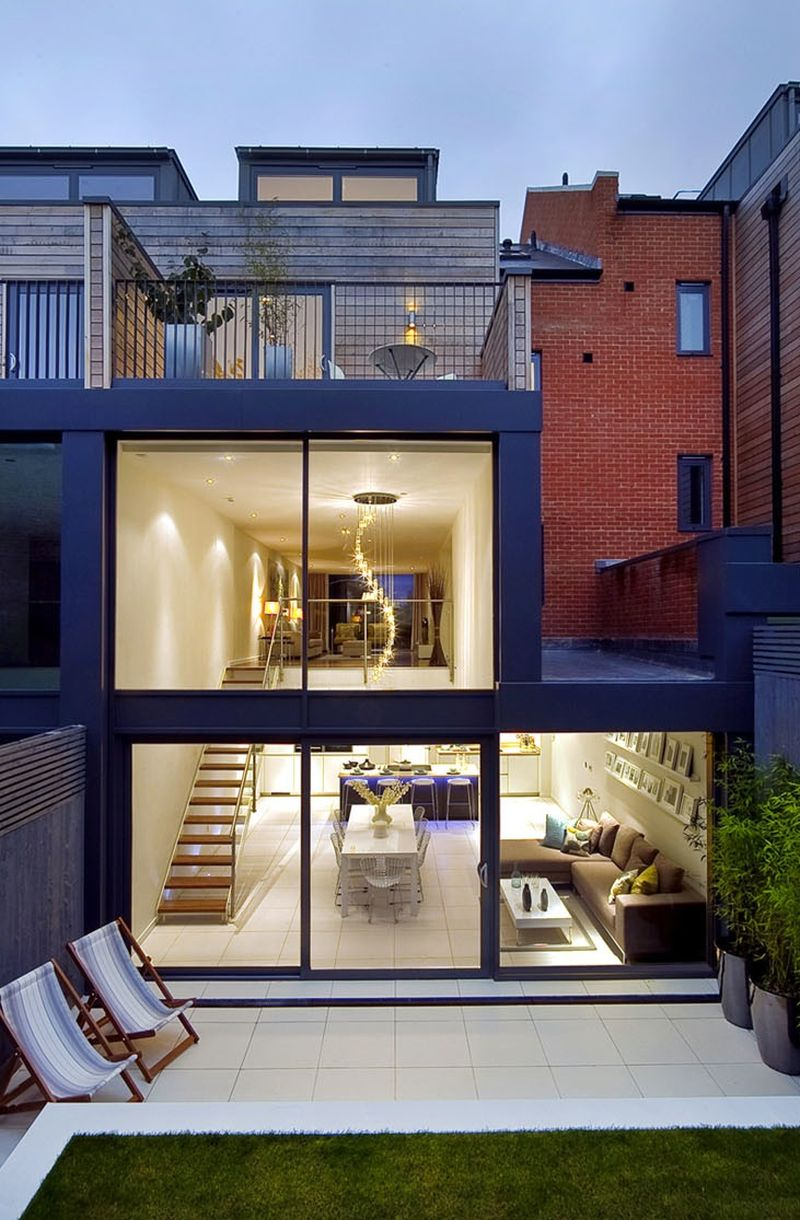 View of the backyard and the glass structure Private London Residence Sizzles With Smart Decor And A Dramatic Glass Feature